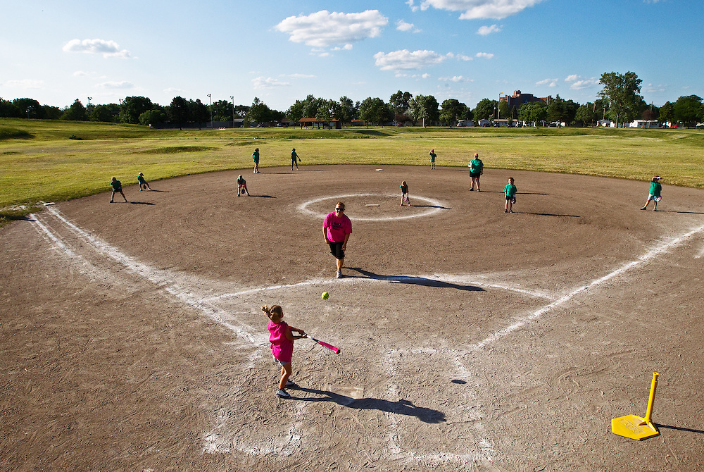 Young girls ages 8 and under play a game of softball Wednesday evening at the Bob Sorensen Softball Complex in Grand Island. Finding a field to play or practice on has become increasingly challenging as interest in softball has grown in Grand Island. (Independent/Matt Dixon)