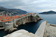 Elevated view from Fortress Lovrinjenac (Fort of Saint Lawrence) of Dubrovnik old town and Island of Lokrum