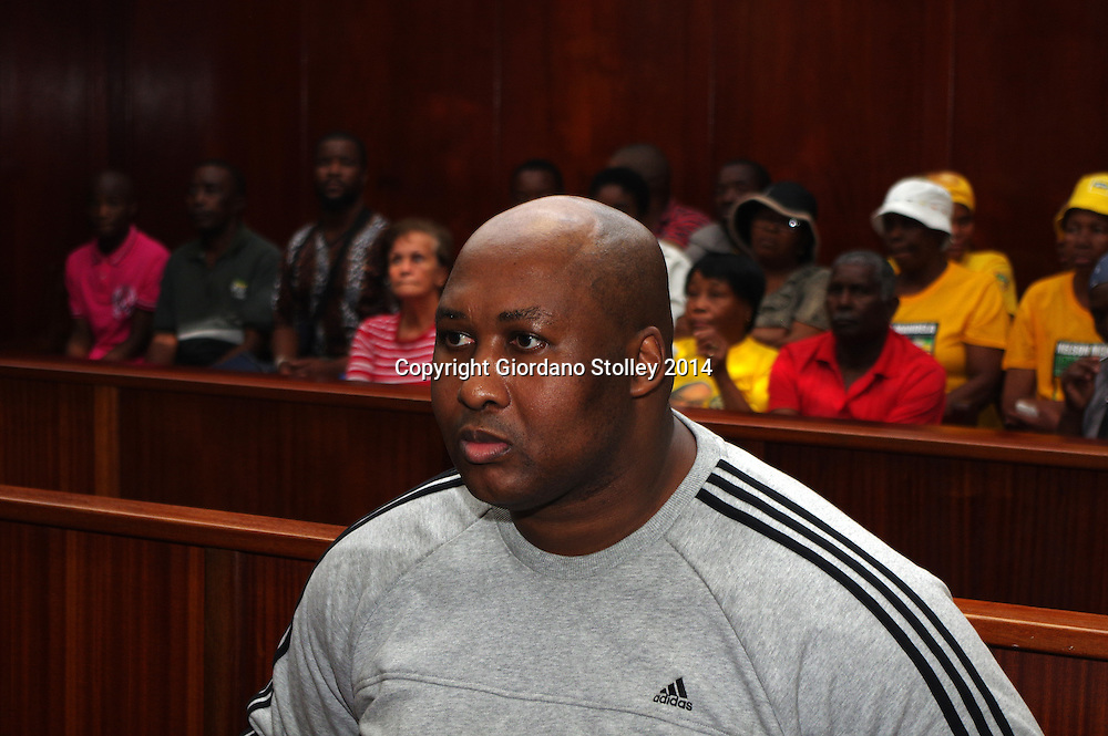 DURBAN - 26 September 2014, Former Blue Bulls rugby player Phindile Joseph Ntshongwana who killed four people with an axe, tried to kill two others, raped another and assaulted  another person sits in the dock in the Durban High Court before Acting Judge Irfaan Khalil still had to rule whether he was criminally responsible for his actions. Picture: Allied Picture Press/APP