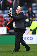 Leeds United Manager Steve Evans celebrates the win at the end of the game. Skybet football league Championship match, Huddersfield Town v Leeds United at the John Smith's Stadium in Huddersfield, Yorks on Saturday 7th November 2015.<br /> pic by Chris Stading, Andrew Orchard sports photography.