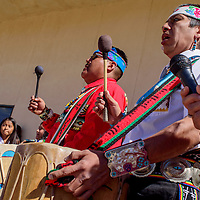 Lyndon Gasper and Mangaysha Kallestewa, right, drum and sing for the dancers during the Indigenous Peoples' Day celebration at Six Directions School in Gallup Monday.