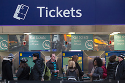 © under license to London News Pictures. 02/01/14. An average 2.8% increase in rail fares comes into effect on Thursday 2nd Jan 2014, pushing the cost of some commuter travel to more than £5,000 a year. FILE PICTURE DATED:  28/11/2012. Passenger buying train tickets at Victoria Train Station. Rail fares set to increase by an average of 4.2% in January, a watchdog has revealed. Photo credit: Tolga Akmen/LNP
