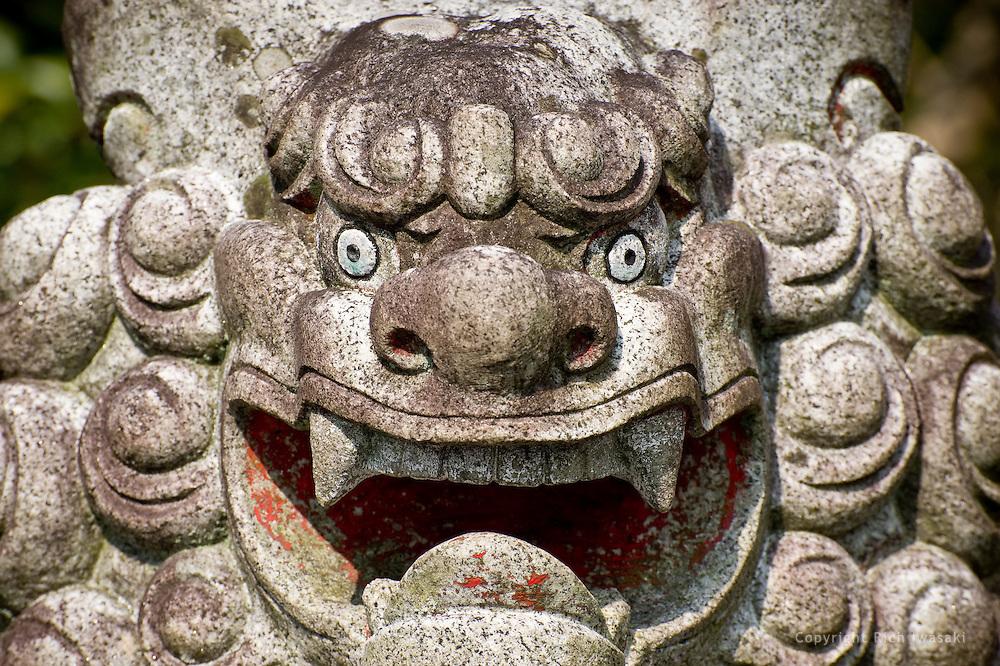 Close-up view of stone lion at Sumiyoshi jinja (shrine) in Saiki, Oita Prefecture, Japan