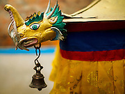 06 AUGUST 2015 - KATHMANDU, NEPAL:  A dragon's head and bell on a corner of the Drubgon Jangchup Choeling Buddhist monastery in Kathmandu.     PHOTO BY JACK KURTZ