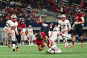 Clayton Kent #11 of the Iraan High School football team is tripped up during the state championship game at AT&T Stadium in Arlington, Texas on December 15, 2016. (Cooper Neill for The New York Times)