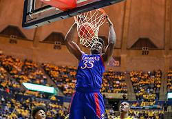 Feb 12, 2020; Morgantown, West Virginia, USA; Kansas Jayhawks center Udoka Azubuike (35) drunks the ball during the first half against the West Virginia Mountaineers at WVU Coliseum. Mandatory Credit: Ben Queen-USA TODAY Sports