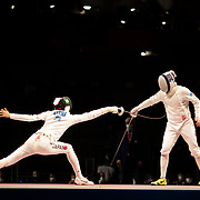 TOKYO, JAPAN - JULY 30:   Satoru Uyama of Japan (left)(left) in action against Nikita Glazkov of ROC during the Japan V ROC gold medal match won by Japan 45-36  during the fencing epee team event for men at the Makuhari Messe at the Tokyo 2020 Summer Olympic Games on July 30, 2021 in Tokyo, Japan. (Photo by Tim Clayton/Corbis via Getty Images)
