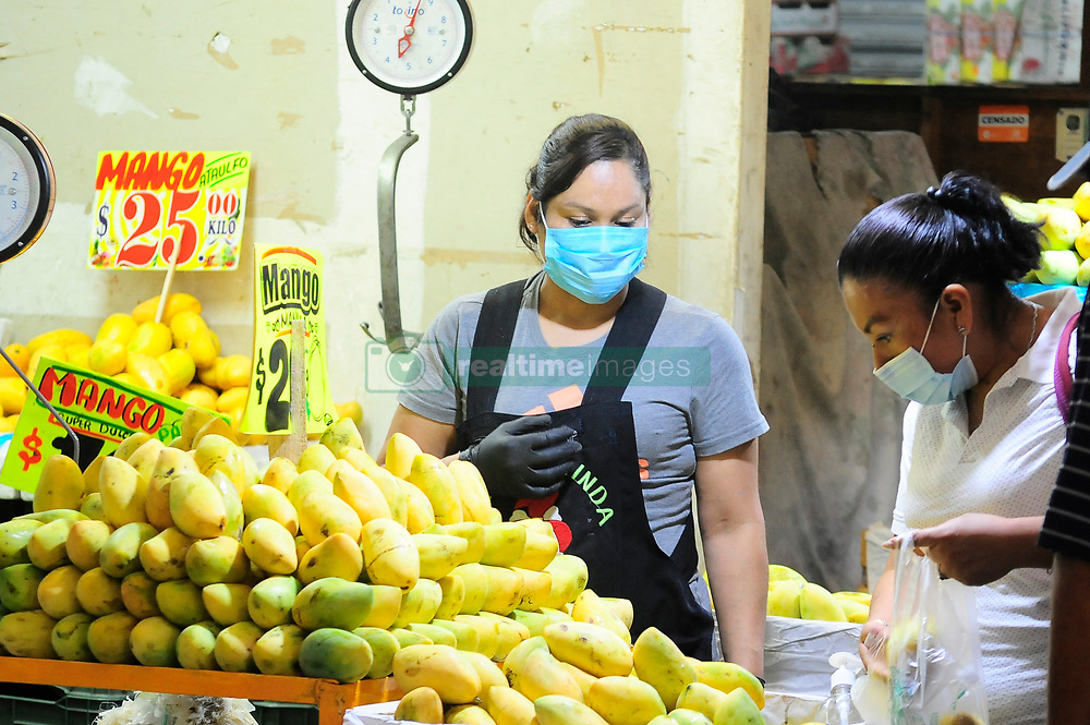 A seller wears protective mask as safety measure against COVID-19 to offers his products to shoppers at Central de Abasto Market during the daily life amid of Coronavirus outbreak in phase 3. The Central de Abasto is the largest and most important market in Mexico and food provider which has increased its security measures due to recent positive cases among sellers . on April 27, 2020 in Mexico City, Mexico. Photo by Ricardo Castelan Cruz/Eyepix/ABACAPRESS.COM