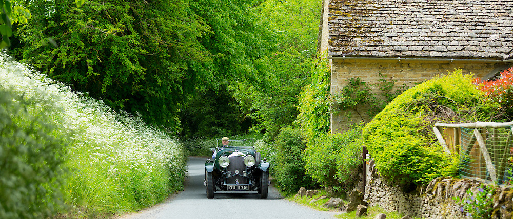 Vintage Bentley 4.5 litres car built in 1929 being driven on touring holiday along country lanes in The Cotswolds, UK