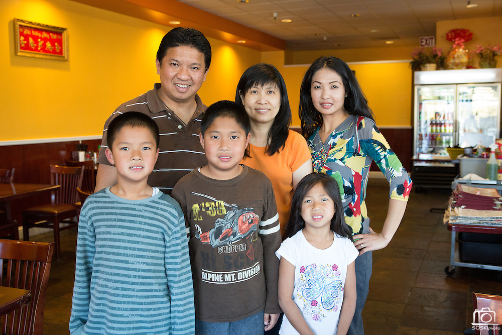 Owner Kevin Tran poses with his wife, May Tran (orange shirt), sister, Stephanie Tran (right), and his niece and nephews in the dining room of Pho Saigon Noodle House in Milpitas, Calif., on Sept. 19, 2012.  Pho Saigon Noodle House was awarded Milpitas' Best Bowl of Pho for 2012.  Photo by Stan Olszewski/SOSKIphoto.