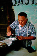 Portrait tailor ironing