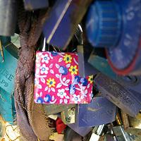 Europe, France, Paris. Pink Love-lock on the Pont de l'Archevêché over the Seine.