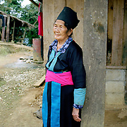 Portrait of an elderly White Hmong woman wearing traditional clothing outside her home in Ban Phou Lang Chang village, Luang Prabang province, Lao PDR. One of the most ethnically diverse countries in Southeast Asia, Laos has 49 officially recognised ethnic groups although there are many more self-identified and sub groups. These groups are distinguished by their own customs, beliefs and rituals.