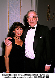 SIR JAMES SPICER MP and MRS LORRAINE POWELL at a reception in London on November 25th 1996.LTT 120