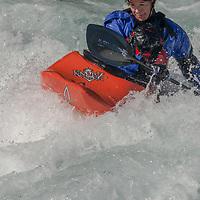 Kayaker Isabelle Filion paddles through rapids in the Kananaskis River near Calgary, Alberta, Canada.