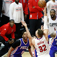 11 March 2017: LA Clippers forward Blake Griffin (32) goes for the baby hook over Philadelphia 76ers forward Dario Saric (9) and Philadelphia 76ers center Jahlil Okafor (8) during the LA Clippers 112-100 victory over the Philadelphia Sixers, at the Staples Center, Los Angeles, California, USA.