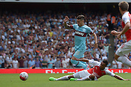 Francis Coquelin of Arsenal tackles Dimitri Payet of West Ham United. Barclays Premier League, Arsenal v West Ham Utd at the Emirates Stadium in London on Sunday 9th August 2015.<br /> pic by John Patrick Fletcher, Andrew Orchard sports photography.
