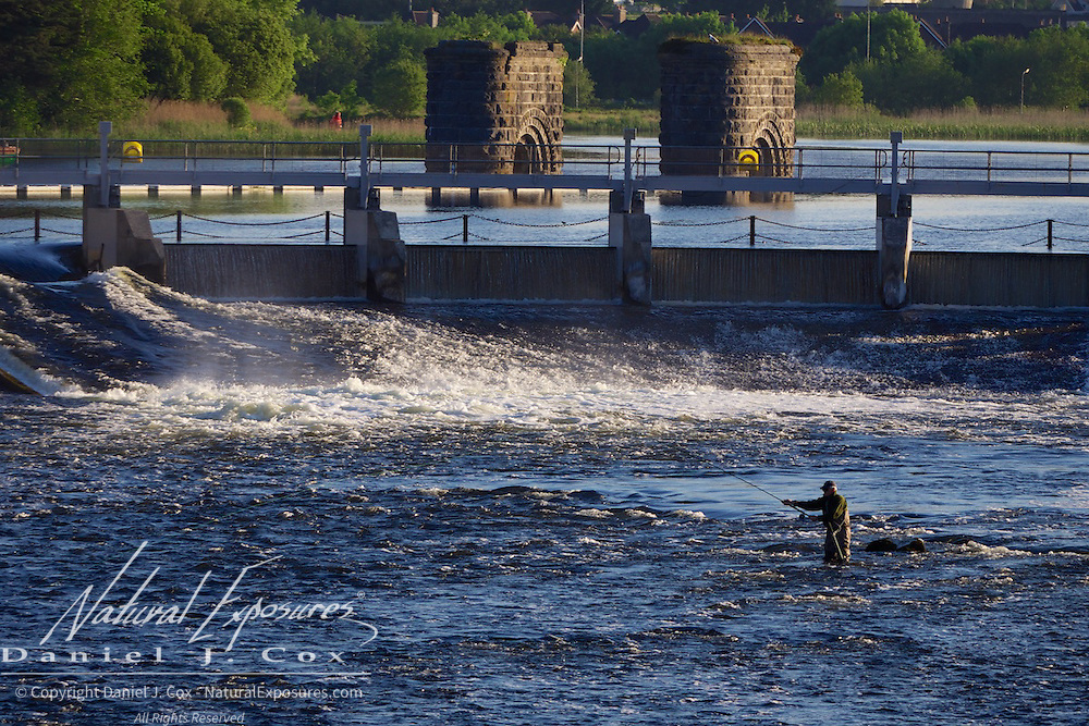 A salmon fisherman in the river just down from the spillway on the Coribb river, Galway, Ireland