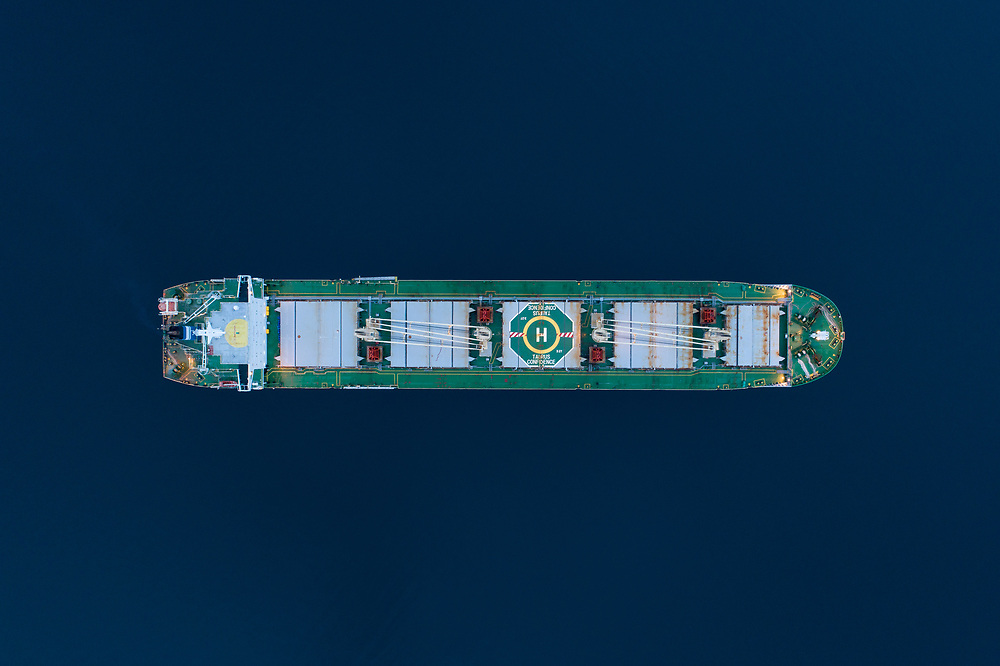 Top down view of the bulk carrier 'Taurus Confidence' anchored in the port of Narvik in Northern Norway.
