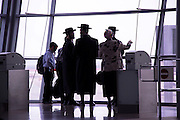 Israel, Ben Gurion Airport, Silhouette of passengers in the departure lounge awaiting their flight
