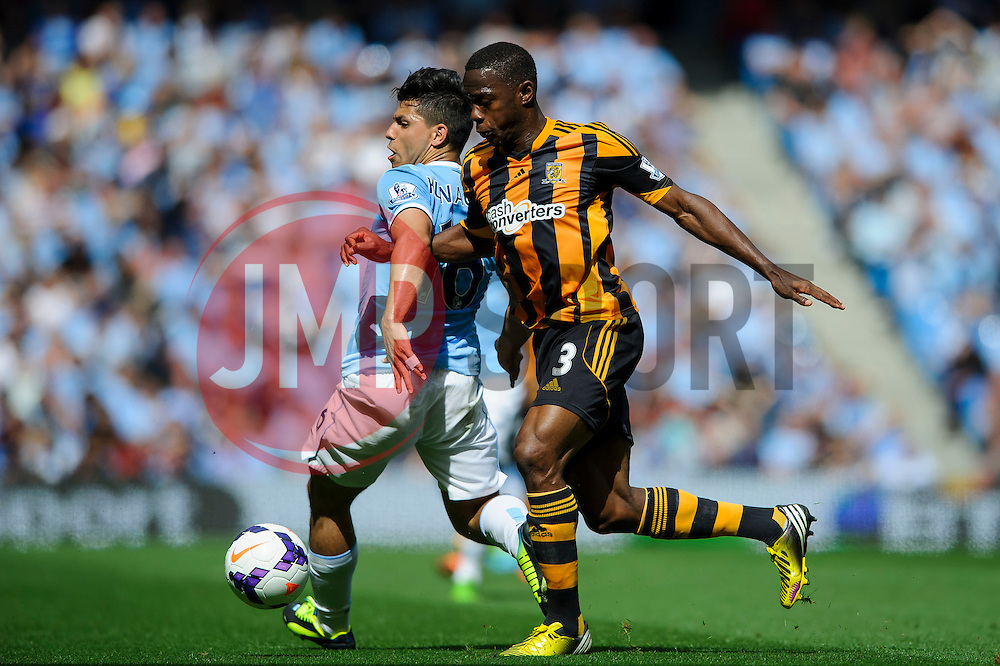 Man City Forward Sergio Aguero is challenged by Hull Defender Maynor Figueroa (HON) during the first half of the match - Photo mandatory by-line: Rogan Thomson/JMP - Tel: Mobile: 07966 386802 31/08/2013 - SPORT - FOOTBALL - Etihad Stadium, Manchester - Manchester City v Hull City Tigers - Barclays Premier League.