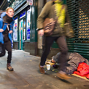 Homeless people sleeping on streets of Glasgow. A man lies sleeping under the 'Hielanman's' umbrella on Argyle Street. <br /> <br /> Picture Robert Perry 16th March 2017<br /> <br /> Must credit photo to Robert Perry<br /> FEE PAYABLE FOR REPRO USE<br /> FEE PAYABLE FOR ALL INTERNET USE<br /> www.robertperry.co.uk<br /> NB -This image is not to be distributed without the prior consent of the copyright holder.<br /> in using this image you agree to abide by terms and conditions as stated in this caption.<br /> All monies payable to Robert Perry<br /> <br /> (PLEASE DO NOT REMOVE THIS CAPTION)<br /> This image is intended for Editorial use (e.g. news). Any commercial or promotional use requires additional clearance. <br /> Copyright 2014 All rights protected.<br /> first use only<br /> contact details<br /> Robert Perry     <br /> 07702 631 477<br /> robertperryphotos@gmail.com<br /> no internet usage without prior consent.         <br /> Robert Perry reserves the right to pursue unauthorised use of this image . If you violate my intellectual property you may be liable for  damages, loss of income, and profits you derive from the use of this image.