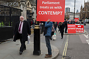 A day after Commons Speaker John Bercow announced his refusal to accept Prime Minster Theresa Mays third Brexit Meaningful Vote, a Brexiteer holds a sign about parliaments contemptuous treatment of its people, on 19th March 2019, in London, England.