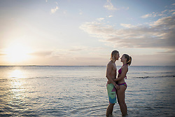 Young couple standing face to face at beach, Mauritius