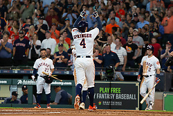 May 23, 2018 - Houston, TX, U.S. - HOUSTON, TX - MAY 23: Houston Astros right fielder George Springer (4) reacts after hitting a two-run homer in the fifth inning during MLB baseball game between the Houston Astros and the San Francisco Giants on May 23, 2018 at Minute Maid Park in Houston, Texas. (Photo by Juan DeLeon/Icon Sportswire) (Credit Image: © Juan Deleon/Icon SMI via ZUMA Press)