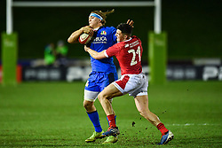 Lorenzo Cannone of Italy is tackled by Ellis Bevan of Wales <br /> <br /> Photographer Craig Thomas/Replay Images<br /> <br /> U20 Six Nations - Wales v Italy  - Friday 31st January 2020 - Stadiwm Zip World (Parc Eirias) - Colwyn Bay<br /> <br /> World Copyright © Replay Images . All rights reserved. info@replayimages.co.uk - http://replayimages.co.uk