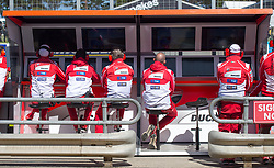 October 20, 2017 - Melbourne, Victoria, Australia - Ducati mechanics watch the monitors during the first free practice session of the MotoGP class at the 2017 Australian MotoGP at Phillip Island, Australia. (Credit Image: © Theo Karanikos via ZUMA Wire)
