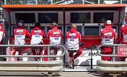 October 20, 2017 - Melbourne, Victoria, Australia - Ducati mechanics watch the monitors during the first free practice session of the MotoGP class at the 2017 Australian MotoGP at Phillip Island, Australia. (Credit Image: © Theo Karanikos via ZUMA Wire)