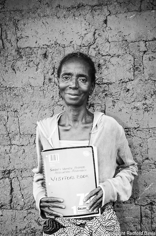 In the village of Robombeh, not far from Mabamboo, I meet the only woman in the village who can read. She proudly displays her visitor log book, which I sign before I take this picture. She was very nice, very sweet woman.