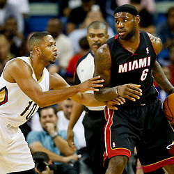 Oct 23, 2013; New Orleans, LA, USA; Miami Heat small forward LeBron James (6) is guarded by New Orleans Pelicans shooting guard Eric Gordon (10) during the second half of a preseason game at New Orleans Arena. The Heat defeated the Pelicans 108-95. Mandatory Credit: Derick E. Hingle-USA TODAY Sports