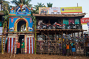 The 'vadivasal' from which the bulls enter on the left next to some of the prizes that can be won by participants who tame the bull for the longest distance or the bull owner whose animal is unable to be tamed.