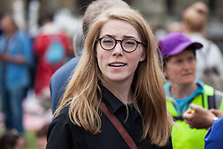 London, UK. 23rd April 2019. Actress Hannah Morrish seen with climate change activists from Extinction Rebellion at an assembly in Parliament Square before an attempt to deliver letters requesting meetings to discuss climate change with Members of Parliament.