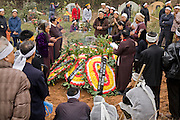 Family members and friends gather at the funeral of Trieu Thi Chat,  who died at the age of 95 in Van Phuc Village, near Hanoi, Vietnam.