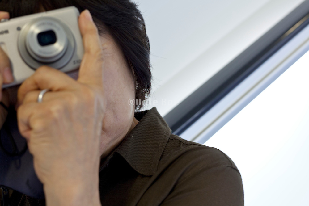 person making pictures with point and shoot camera