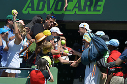 March 30, 2018 - Miami, FL, United States - KEY BISCAYNE, FL - MARCH 30: John Isner (USA) signs autographs after defeating Juan Martin Del Potro (ARG) 61 76(2) in action during day 12 of the 2018 Miami Open held at the Crandon Park Tennis Center on March 29, 2018 in Key Biscayne, Florida. Credit: Andrew Patron/Zuma Wire (Credit Image: © Andrew Patron via ZUMA Wire)