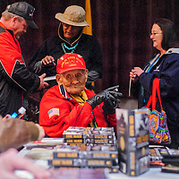 010414       Cable Hoover<br /> <br /> Codetalker Chester Nez sits with his biographer as he signs copies of his memoir during a meet and greet at the WWI film festival at El Morro Theater Saturday.