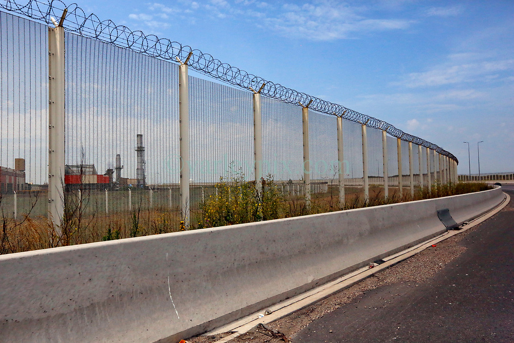 26 June 2020. Calais, France.<br /> Thousands of kilometres of high security fencing rings many of the key cross channel infrastructure in and around calais and Sangatte in even increasing efforts to deter migrants from illegally making the crossing between France and Britain.<br /> Photo©; Charlie Varley/varleypix.com