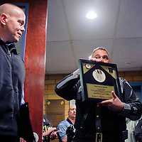 111214       Cable Hoover<br /> <br /> New Mexico State Police major Darren Soland, left, receives a plaque from chief Pete Kassetas at Soland's retirement ceremony at NMSP headquarters in Santa Fe Wednesday.