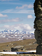 View of the Obelisk and other tors (schist pillars) on the Old Man Mountain Range, Otago, New Zealand; the Garve Mountain Range is in the distance, to the west
