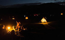 © Licensed to London News Pictures. <br /> 21/06/2014. <br /> <br /> Castlerigg Stone circle, Cumbria, England<br /> <br /> Visitors to the ancient site of Castlerigg Stone Circle near Keswick in Cumbria celebrate through the night as they wait for the sunrise on the morning of the Summer Solstice.<br /> <br /> Photo credit : Ian Forsyth/LNP