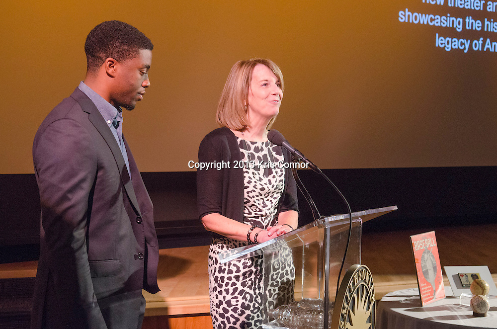 """WASHINGTON, DC - APRIL 15:  Chadwick Boseman and Carol Melton, Executive Vice President for Global Public Policy of Time Warner Inc, speak during  the Washington DC screening of Warner Bro's film """"42"""" at Smithsonian Museum of American History on April 15th, 2013. Guests included star of the film Chadwick Boseman, John Gray, Carol Melton, and Lonnie Bunch. Photo by Kris Connor/Warner Bros"""