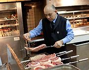 Porcao Rios rodizio restaurant, in the kitchen preparing the beef cuts. Rio de Janeiro.