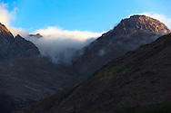High Atlas Mountains at sunrise with morning fog, Tizi-n-Tichka, Morocco.