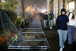 © Licensed to London News Pictures. 05/11/2020. Manchester, UK. Hundreds of students protest and march through the campus , tearing down fences where The University of Manchester have erected fencing around student accommodation blocks , at the Owens Park campus of the UoM , on the first day of a national coronavirus lockdown in England . Students living at halls of residence on the site say no notification was given ahead of the erection of fences , which the university claims are for students' security. Photo credit: Joel Goodman/LNP