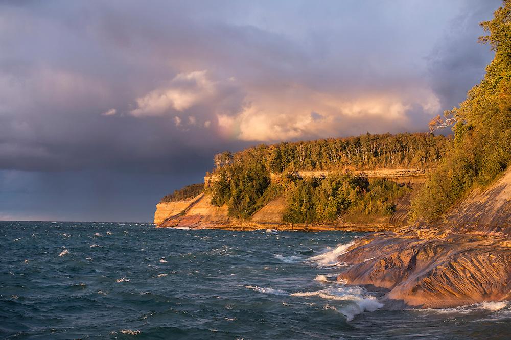 Lake Superior waves crash under a dramatic sky at Pictured Rocks National Lakeshore near Munising, Michigan.