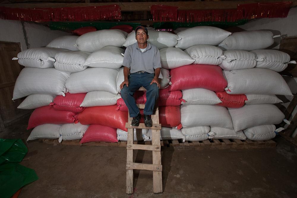 Cristóbal Molina, member of the board of CABRIPEL, in the warehouse of the coop. Cooperativa Agropecuaria Brisas del Pelón Ltda, CABRIPEL, is a certified organic and Fairtrade coffee-producing cooperative with 50 members based in Estanzuelas, Marcala, La Paz, Honduras.